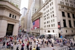 14833643 - new york, new york, usa - july 4, 2012: the intersection of wall street and broad street including landmark buildings of the new york stock exchange on independence day