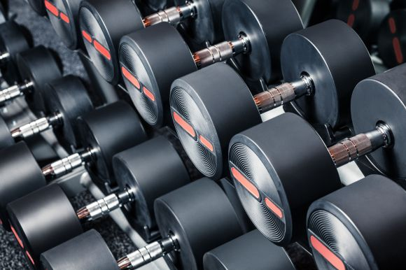 30497758 - series of dumbbells are on stand at the gym